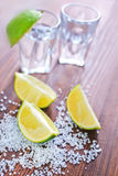 Limes and tequila Royalty Free Stock Photography