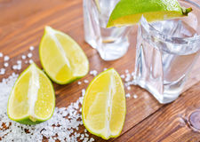 Limes and tequila Stock Image