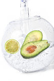 Limes in water avocado Royalty Free Stock Photos