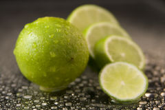Limes with Water Drops Stock Photo