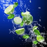 Limes in water splash Royalty Free Stock Images