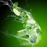 Limes with water splash Royalty Free Stock Photography
