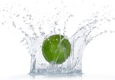 Limes with water splash Stock Photos