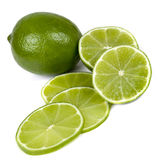 Limes  on White. Limes, sliced and whole,  on white background Royalty Free Stock Photo