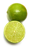 Limes on white background. Royalty Free Stock Image