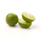 Limes on white background. Limes with half isolated on white background Stock Image