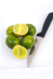 Limes on the white background Royalty Free Stock Images