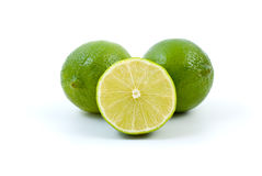 Limes. Whole and half. Isolated on the white background Stock Image