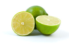 Limes. Whole and halves. Isolated on the white background Royalty Free Stock Photo