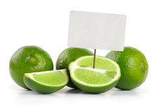 Limes whole and slices with price tag Stock Photo