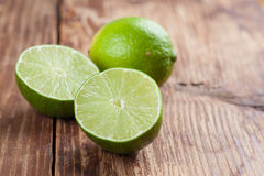 Limes on wooden background Royalty Free Stock Image