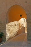 Limestone archway. With warm evening sunlight forming golden shadows. Ancient town of Mdina, Malta stock photos