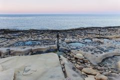 Limestone beach in malta at sunset Royalty Free Stock Image