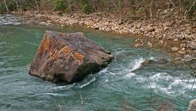 Iron Oxide Boulder In Stream stock photography