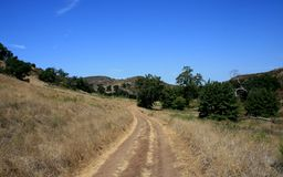 Limestone Canyon Road 2. Dirt road through a field, Limestone Canyon, California Stock Photography