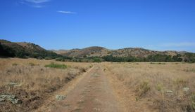 Limestone Canyon Road. Dirt road through a field, Limestone Canyon, California Stock Images