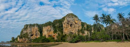Beautiful scenic limestone cliff in Krabi, Thailand long panorama. Limestone cliff in Krabi, Thailand. Beautiful paradise view scenic coastline Phi Phi island stock photo