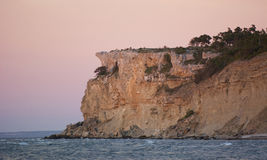 Limestone cliff next to the ocean. High limestone cliff on the island of Gotland in the Balticsea in sweden Royalty Free Stock Images