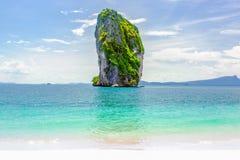 Limestone cliff over crystal clear sea on tropical island, Krabi Stock Photos