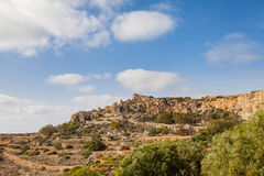Limestone cliff of Southern shore of Malta island. Summer sunny day. Panoramic view. Stock Photos