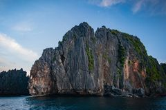 Limestone cliff at sunset off Miniloc Island, El nido region of Palawan in the Philippines stock photos