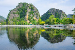 Limestone cliffs, Ngo river in Tam Coc Grotto Royalty Free Stock Photography