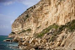Limestone cliffs of the peninsula Akrotiri, Cyprus Royalty Free Stock Image
