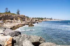 Limestone Cliffs: South Cottesloe Beach. Turquoise Indian Ocean waters and rocky coast line at South Cottesloe Beach with limestone formations and cliffs under a Stock Photography