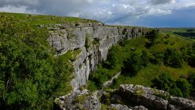 Limestone Cliffs In Yorkshire. Limestone cliffs with dark sky Royalty Free Stock Photo