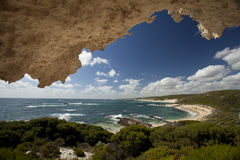 Limestone Coast. Redgate Beach Margaret River framed by a limestone overhang Royalty Free Stock Photo