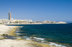 Limestone coastline view of st. julians malta. View of limestone beach mediterranean sea coastline and paceville st. julians hotels condominiums development from Royalty Free Stock Photography