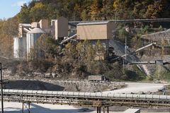 Limestone or crushed stone factory in wooded valley Royalty Free Stock Photos