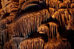Limestone drapery shapes in Soreq Cave, Israel. Beautiful limestone drapery shapes in Soreq Cave, Israel Stock Images