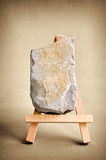 Limestone easel. Blank limestone surface on easel in front of brown BG royalty free stock image