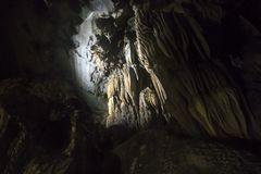 Limestone formations in karst cave at Cat Ba island, Vietnam, stalactites and stalagmites inside the cave. Limestone formations in karst cave at Cat Ba island royalty free stock photography