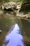 Limestone gorge river in mountains. Limestone gorge in carpathians mountains calm flowing river water reflection royalty free stock photography