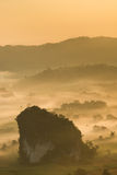 The limestone hill with foggy background during sunrise Stock Photos