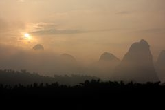 Limestone hills in mist, China Royalty Free Stock Image
