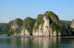 Limestone island and boat in the sea royalty free stock photo
