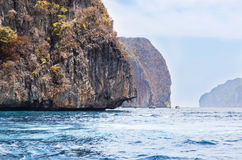 Limestone island  at coastline in andaman sea Royalty Free Stock Photos