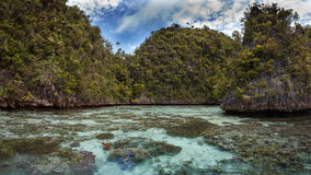 Limestone island in the lagoon,Raja ampat,Indonesia 01 Stock Photo