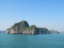 Limestone island in the sea bay stock images