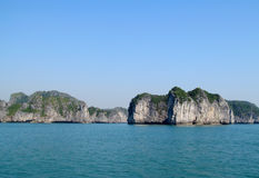 Limestone island in the sea bay royalty free stock photo