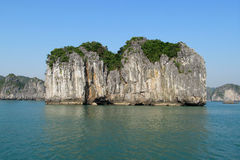 Limestone island in the sea bay stock photo