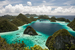 Limestone Islands. Oddly shaped limestone islands make up Wayag, a group of uplifted reefs in eastern Indonesia. This area is part of Raja Ampat, the heart of Royalty Free Stock Photography