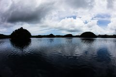 Limestone Islands in Palau`s Calm Lagoon Royalty Free Stock Image