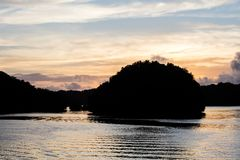 Limestone Islands in Palau`s Calm Lagoon at Sunrise Royalty Free Stock Photo