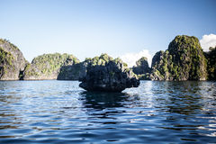 Limestone Islands 2. Rugged limestone islands emerge from the tropical seas of eastern Indonesia near Papua. These islands are ancient reefs that were uplifted Stock Image