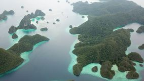 Limestone Islands and Tropical Lagoon in Raja Ampat. The gorgeous limestone islands of Wayag, Raja Ampat, are surrounded by shallow coral reefs. This remote stock video