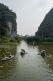 Limestone Landscape with River, Rowing Boats and Water Lilies, Tam Coc, Vietnam Stock Images
